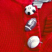 ball buttons on ugly sports sweater
