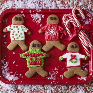 gingerbread cookies wearing ugly Christmas sweaters